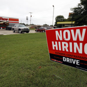 A bilingual help wanted sign for Auto Zone, a retailer of aftermarket automotive parts and accessories, is posted outside the store in Canton, Miss., Thursday, Sept. 27, 2018. The central Mississippi city has a growing Spanish-speaking population and some merchants are actively recruiting bilingual counter help. (AP Photo/Rogelio V. Solis)