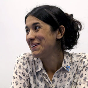 Human rights activist Nadia Murad speaks during an interview with The Associated Press at the International Center in Vienna, Austria, Monday, May 22, 2017. Murad managed to flee months of IS captivity as a sex slave, But a one-word comment from her shows how deep the scars from the ordeal sit more than two years after her escape. (AP Photo/Ronald Zak)