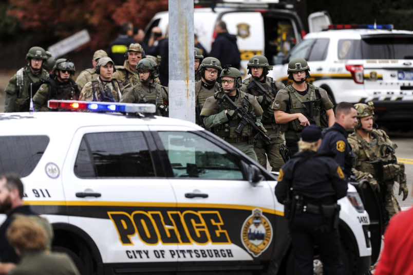 Law enforcement officers secure the scene where multiple people were shot, Oct, 27, 2018, at The Tree of Life Congregation synagogue in Squirrel Hill. (Alexandra Wimley/Pittsburgh Post-Gazette via AP)