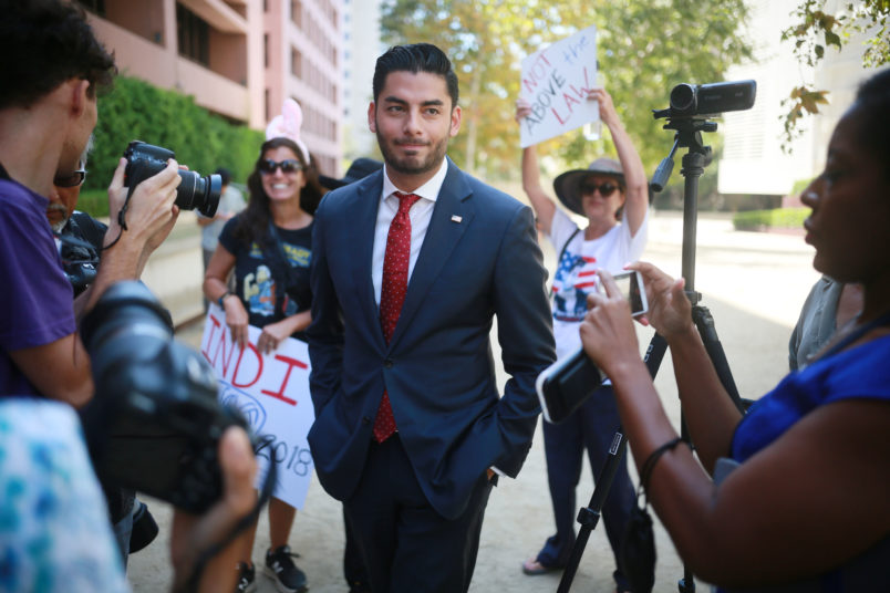 """SAN DIEGO, CA-AUG 23: Ammar Campa-Najjar, who is running against Congressman Duncan Hunter, speaks to reporters outside the San Diego Federal Courthouse during Congressman Hunter's arraignment hearing on Thursday, August 23, 2018 in San Diego, CA. Hunter and his wife Margaret, who pled """"not guilty"""", are accused of using more than 250,00 in campaign funds for personal use.(Photo by Sandy Huffaker/Getty Images)"""
