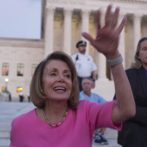 WASHINGTON, D.C. - OCTOBER 3: House minority leader Nancy Pelosi mingles with a crowd, mostly of women, who have gathered outside of the Supreme Court to oppose Judge Kavanaugh's nomination to the Supreme Court on the evening of October 3, 2018 in Washington, D.C. (Photo by Andrew Lichtenstein/Corbis via Getty Images)