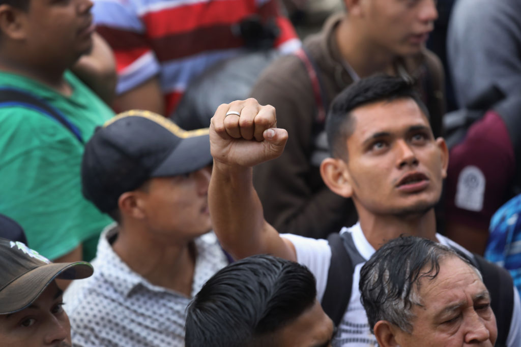 TECUN UMAN, GUATEMALA - OCTOBER 19: Members of a migrant caravan gather before attempting to cross the Guatemalan border into Mexico on October 19, 2018 in Tecun Uman, Guatemala. The caravan of thousands of Central Americans, mostly from Honduras, hopes to eventually reach the United States. U.S. President Donald Trump has threatened to cancel the recent trade deal with Mexico and withhold aid to Central American countries if the caravan isn't stopped before reaching the U.S.  (Photo by John Moore/Getty Images)