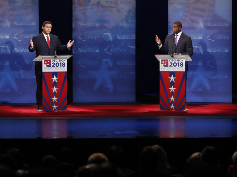 Florida gubernatorial candidates, Republican Ron DeSantis, left, and Democrat Andrew Gillum debate, Wednesday, Oct. 24, 2018, at Broward College in Davie, Fla. (AP Photo/Wilfredo Lee, Pool)