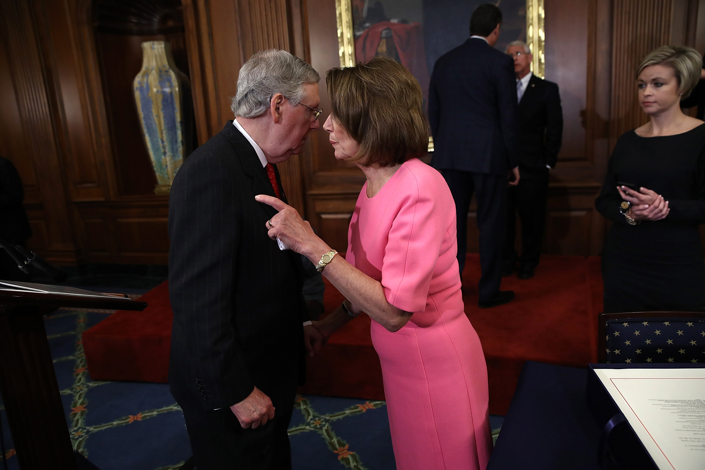 WASHINGTON, DC - DECEMBER 08:  U.S. Senate Majority Leader Mitch McConnell (R-KY) speaks with House Minority Leader Rep. Nancy Pelosi (R) (D-CA) following an event marking the passage of the 21st Century Cures Act at the U.S. Capitol December 8, 2016 in Washington, DC. The bill, passed with strong bipartisan support, provides funding for cancer research, the fight against the epidemic of opioid abuse, mental health treatment, aids the Food and Drug Administration in expediting drug approvals and pushes for better use of technology in medicine.  (Photo by Win McNamee/Getty Images)