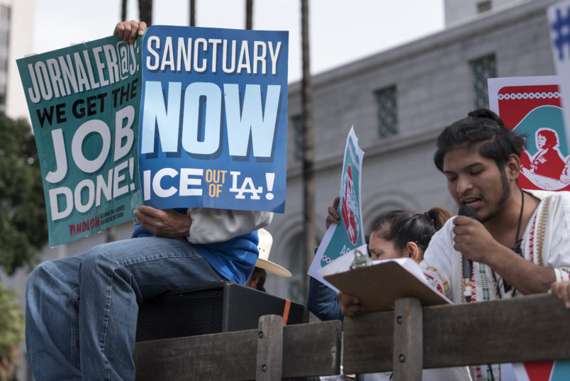 Protesters at a pro-immigration rally where organizers called for a stop to the Immigration and Customs Enforcement (ICE) raids and deportations of illegal immigrants and to officially establish Los Angeles as a sanctuary city. Los Angeles, California February 18, 2017.  (Photo by Ronen Tivony/NurPhoto)