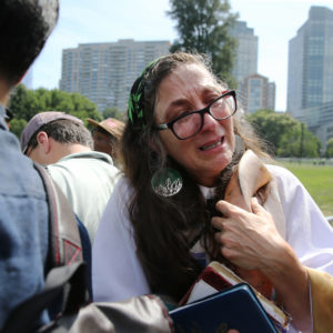 """BOSTON - AUGUST 19: Anne Armstrong embraces her shofar while waiting to enter the """"Boston Free Speech"""" rally where she planned to offer an opening prayer on the Boston Common, Aug. 19, 2017. (Photo by Craig F. Walker/The Boston Globe via Getty Images)"""