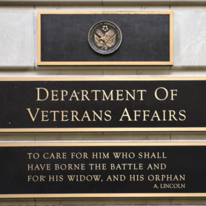 WASHINGTON, D.C. - APRIL 22, 2018:  A metal plaque on the facade of the Department of Veterans Affairs building in Washington, D.C., features a quotation by Abraham Lincoln. (Photo by Robert Alexander/Getty Images)