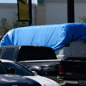 A van covered in blue tarp is towed by FBI investigators on October 26, 2018, in Plantation, Florida, in connection with the 12 pipe bombs and suspicious packages mailed to top Democrats. - A suspect identified by investigators as Cesar Sayoc, 56, was arrested near an Auto store in Plantation. (Photo by Michele Eve Sandberg / AFP)        (Photo credit should read MICHELE EVE SANDBERG/AFP/Getty Images)