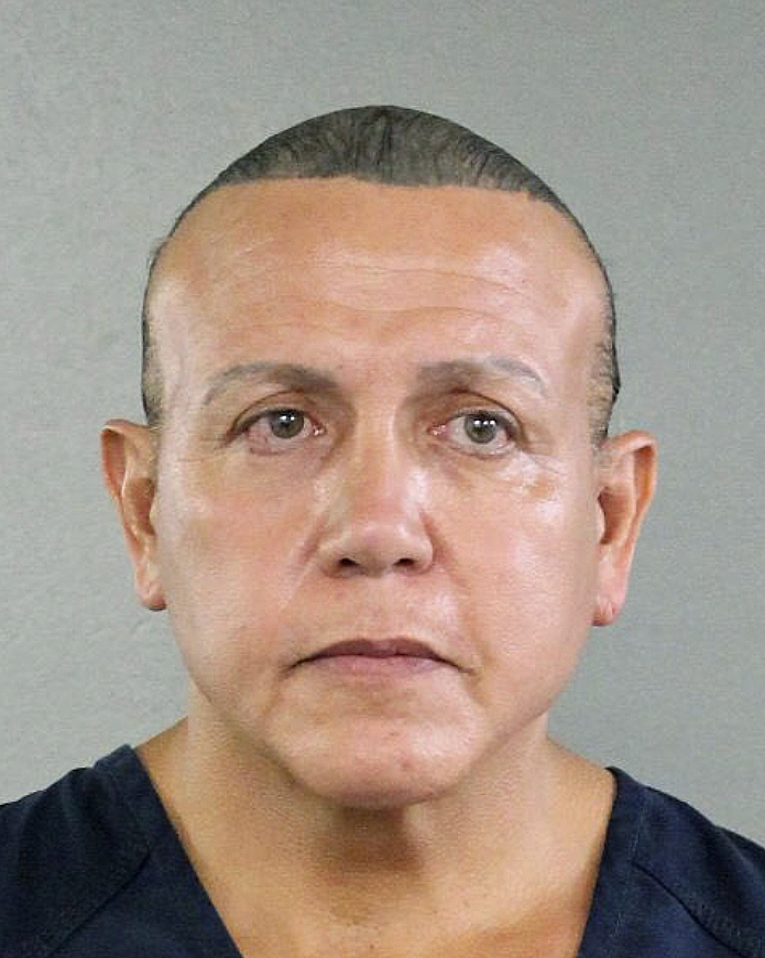 In this undated photo released by the Broward County Sheriff's office, Cesar Sayoc is seen in a booking photo, in Miami. Federal authorities took Cesar Sayoc, 56, of Aventura, Fla., into custody Friday in Florida in connection with the mail-bomb scare that earlier widened to 12 suspicious packages, the FBI and Justice Department said. (Broward County Sheriff's Office via AP)