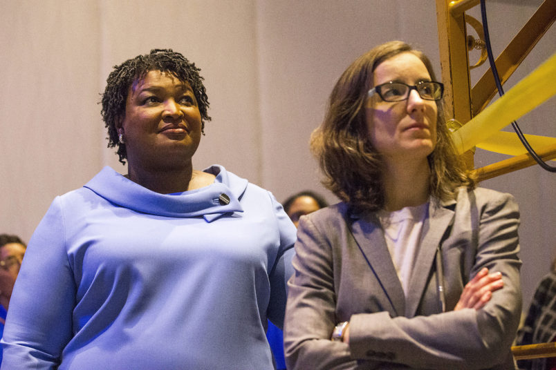 11/07/2018 -- Atlanta, Georgia -- Georgia gubernatorial candidate Stacey Abrams (left) stands with her campaign manager, Lauren Groh-Wargo[cq], before speaking to her supporters during an election night watch party at the Hyatt Regency in Atlanta, Wednesday, November 7, 2018. Georgia's gubernatorial race was too close to call, possibly signaling a run-off election. (ALYSSA POINTER/ALYSSA.POINTER@AJC.COM)