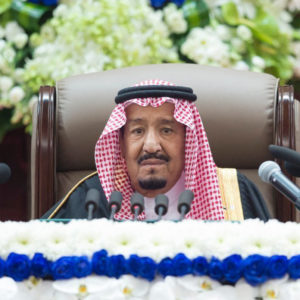 In this photo provided by the Saudi Press Agency, SPA, Saudi King Salman gives his annual policy speech in the ornate hall of the consultative Shura Council, Monday, Nov. 19, 2018, Riyadh, Saudi Arabia. Salman gave his first major speech since the killing of journalist Jamal Khashoggi by Saudi agents, expressing support for his son, the crown prince, and making no mention of the accusations that the prince ordered the killing. Monday's speech highlighted the kingdom's priorities for the coming year, focusing on issues such as the war in Yemen, security for Palestinians, stability in the oil market, countering rival Iran and job creation for Saudis.  (AP Photo/Saudi Press Agency)