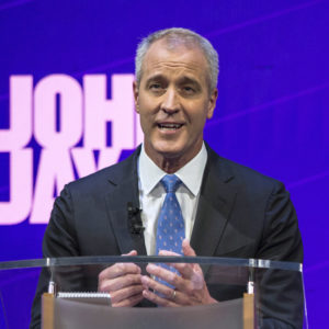 FILE - In this Aug. 28, 2018, file photo, candidate U.S. Rep. Sean Patrick Maloney stands at the podium during a debate by the Democratic candidates for New York State Attorney General at John Jay College of Criminal Justice in New York. The four candidates in the tightly contested primary, Zephyr Teachout, Letitia James, U.S. Rep. Maloney and Leecia Eve have all vowed to be a legal thorn in Republican President Donald Trump's side, opposing his policies on immigration and the environment. And the winner will inherit several pending lawsuits filed by the state that challenge Trump's policies and accuse his charitable foundation of breaking the law. (Holly Pickett/The New York Times via AP, Pool, File)