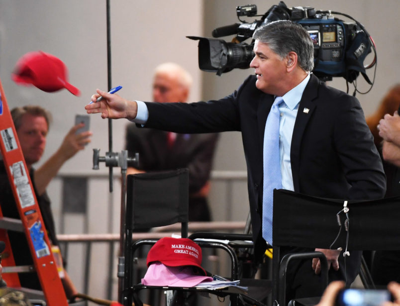 Hannity joins Trump on stage despite claiming he wouldn't
