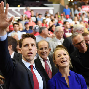 US senatorial candidate Attorney General Josh Hawley (l) and his wife Erin Morrow Hawleyare seen at a rally at JQH Arena in Springfield, Missouri on September 21, 2018. (Photo by MANDEL NGAN / AFP)        (Photo credit should read MANDEL NGAN/AFP/Getty Images)