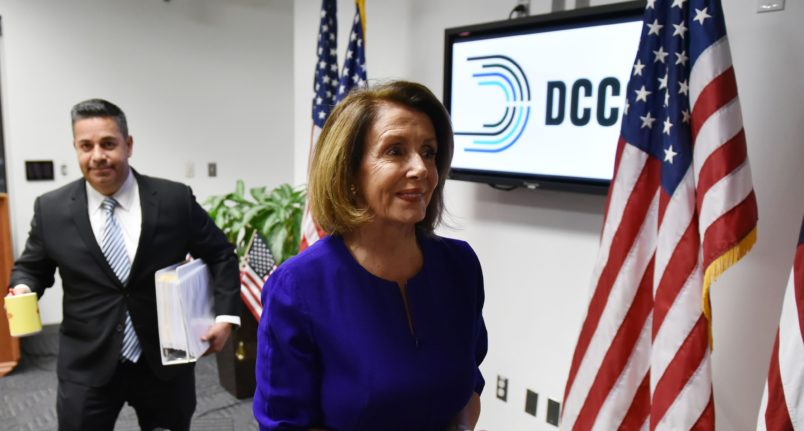 House minority leader Nancy Pelosi, D-CA, departs after a press conference with Democratic Congressional Campaign Committee  Chairman Ben Ray Lujan at Democratic National Committee headquarters in Washington, DC on November 6, 2018. - Americans started voting Tuesday in critical midterm elections that mark the first major voter test of US President Donald Trump's controversial presidency, with control of Congress at stake. (Photo by MANDEL NGAN / AFP)        (Photo credit should read MANDEL NGAN/AFP/Getty Images)