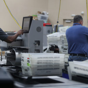 Employees of the Broward County Supervisor of Election's office in Lauderhill, Fla. counts ballots from the Mid-term election Thursday, Nov. 8, 2018. (Carline Jean/Sun Sentinel/TNS)