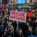 TIMES SQUARE, NEW YORK, UNITED STATES - 2018/11/08: Thousands of New Yorkers joined a coalition of grassroots organizations in New York City in a massive demonstration in Times Square to denounce new acting Attorney General Matthew Whitaker may have a conflict of interest and must not oversee the investigation led by Special Counsel Robert Mueller into Russian interference in the 2016 election and related crimes by Trump campaign officials and associates. (Photo by Erik McGregor/Pacific Press/LightRocket via Getty Images)
