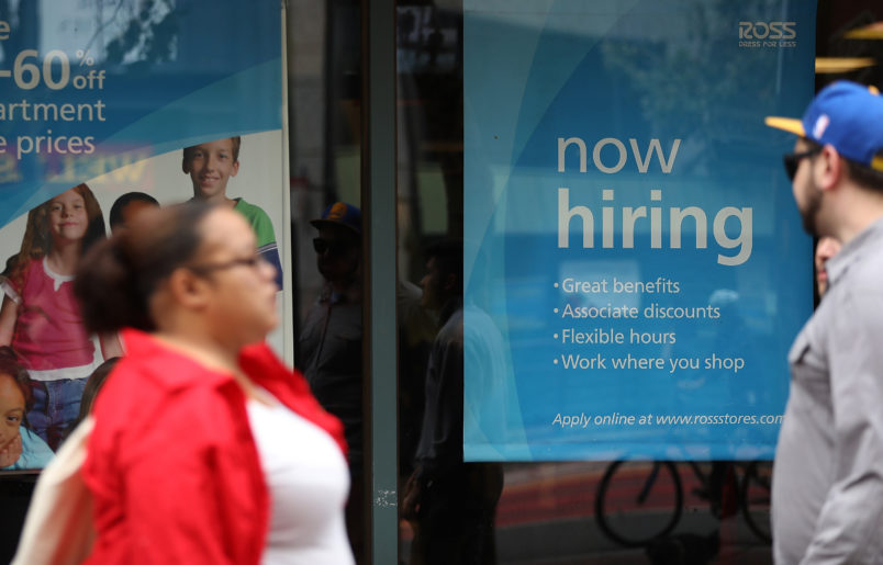 US  job growth surges; annual wage gain biggest since 2009