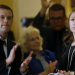 AUGUSTA, ME - JULY 1: House Majority Leader Erin Herbig and House Assistant Majority Leader Jared Golden, left, are met by applause at the State House by dozens of state workers on Saturday, July 1, 2017, the first day of Maine's government shutdown following a a budget impasse that has yet to be resolved. (Staff photo by Derek Davis/Staff Photographer)