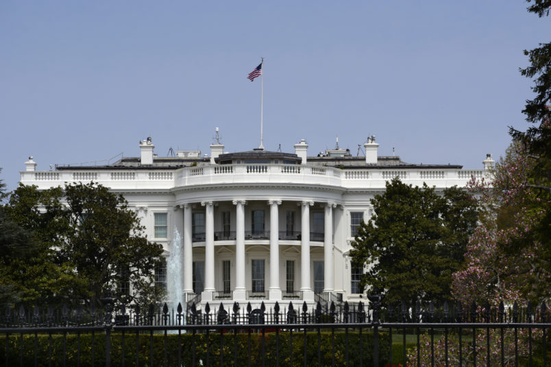 WASHINGTON, D.C. - APRIL 22, 2018:  An American flag flies over the south facade of the White House in Washington, D.C. Additional security fences and barriers were added along the south perimeter to prevent people from jumping the fence and entering the restricted White House grounds. The Secret Service tightened the security on the south side in 2017 by closing access to the entire fence line on the South Lawn. (Photo by Robert Alexander/Getty Images)