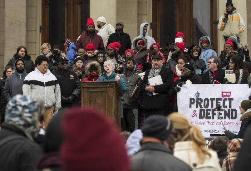 Sister Kathleen Nolan, a member of the Adrian Dominican Sisters in Adrian, Michigan, speaks out against Senate Bill 1171, or Michigan's One Fair Wage proposal, on Wednesday, Nov. 28, 2018, on the steps of the Michigan State Capitol in Lansing, Michigan. It's passage would revoke the raise Michigan's tipped workers get under existing legislation. (AP Photo/Matthew Dae Smith/Lansing State Journal)