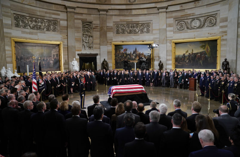 The flag-draped casket of former President George H.W. Bush lies in state in the Capitol Rotunda in Washington, Monday, Dec. 3, 2018. (AP Photo/Pablo Martinez Monsivais/Pool)