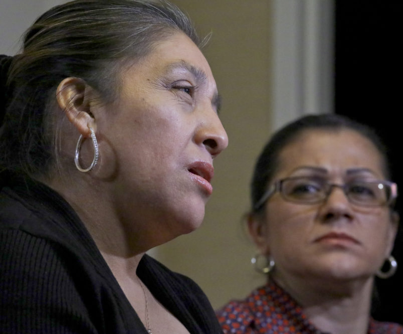 Sandra Diaz, right, listens as Victorina Morales, right recall her experience working at President Donald Trump's golf resort in Bedminster, N.J., during an interview, Friday Dec. 7, 2018, in New York. Both Morales and Diaz say they used false legal documents to get hired at the resort and supervisors knew it. (AP Photo/Bebeto Matthews)