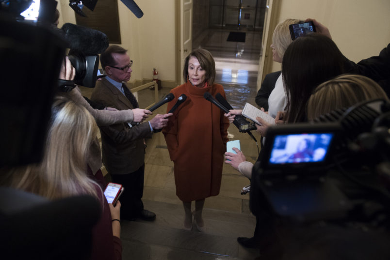 UNITED STATES - DECEMBER 11: House Minority Leader Nancy Pelosi, D-Calif., talks with reporters in the Capitol arriving back from a White House meeting with President Trump, Vice President Pence and Senate Minority Leader Charles Schumer, D-N.Y., about the border wall and a potential government shutdown on December 10, 2018.(Photo By Tom Williams/CQ Roll Call)