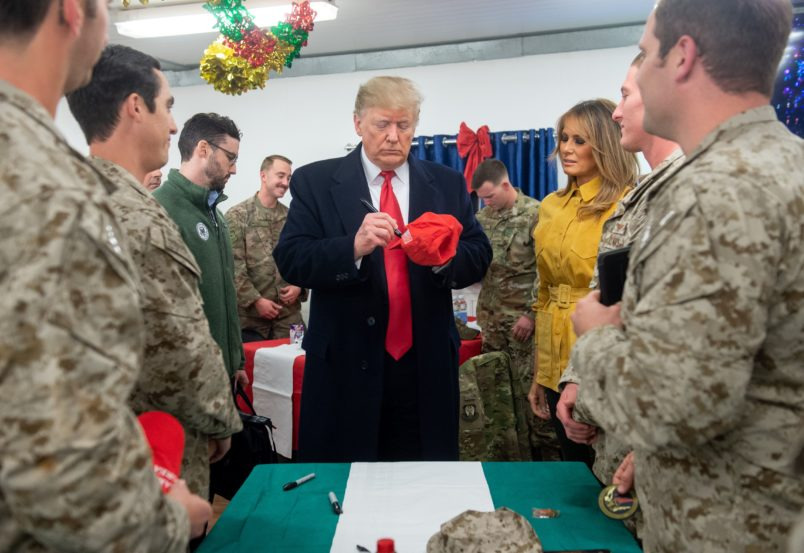 Trump's trip to Iraq comes amid turmoil at home and overseas