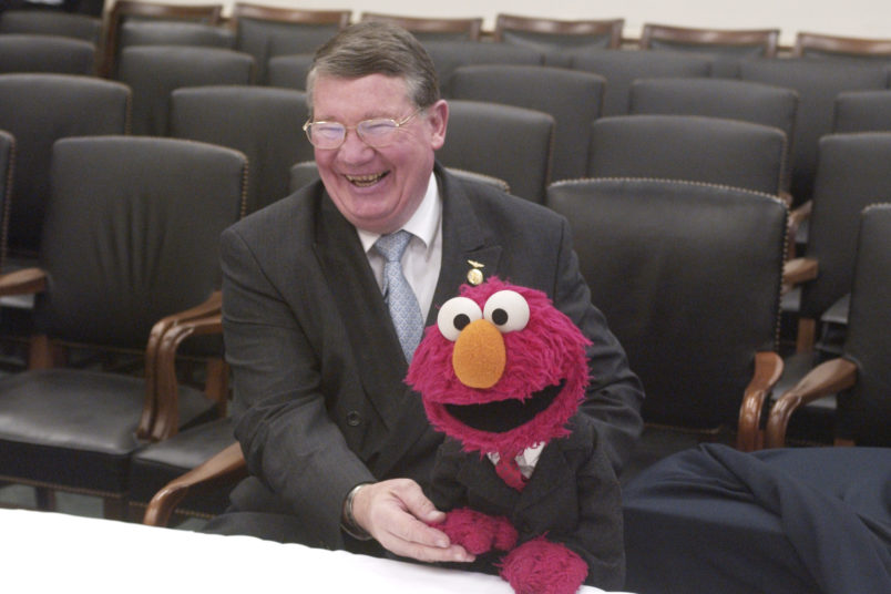 """elmo3/042302 - Rep. Randy """"Duke"""" Cunningham, R-Calif., poses with Elmo, from """"Sesame Street"""", during the furry monster's first appearence on Captiol Hill"""