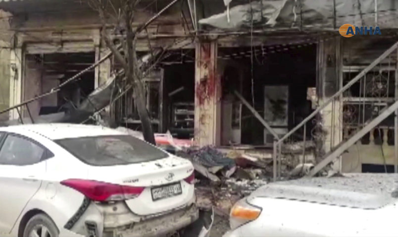 This frame grab from video provided by Hawar news, the news agency for the semi-autonomous Kurdish areas in Syria (ANHA), shows the damaged restaurant where explosion occurred near a patrol of the U.S.-led coalition, in Manbij town, Syria, Wednesday, Jan. 16, 2019. A Syrian war monitoring group and a local town council say an explosion has taken place near a patrol of the U.S.-led coalition and that there are casualties. (ANHA via AP)