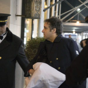 "Michael Cohen arrives at his home with his arm in a sling Thursday, Jan. 18, 2019 in New York. The chairman of the House intelligence committee said he would ""do what is necessary"" to confirm a report that President Donald Trump directed Cohen, then Trump's personal attorney, to lie to Congress about negotiations over a real estate project in Moscow during the 2016 election. (AP Photo/Kevin Hagen)"
