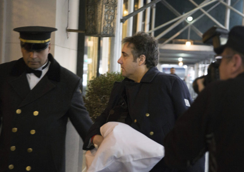 """Michael Cohen arrives at his home with his arm in a sling Thursday, Jan. 18, 2019 in New York. The chairman of the House intelligence committee said he would """"do what is necessary"""" to confirm a report that President Donald Trump directed Cohen, then Trump's personal attorney, to lie to Congress about negotiations over a real estate project in Moscow during the 2016 election. (AP Photo/Kevin Hagen)"""