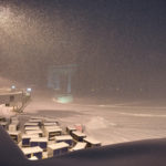 Airline baggage carts sit on the tarmac as crews prepare to move snow at the Albany International Airport in Colonie, N.Y., Sunday, Jan. 20, 2019. (AP Photo/Hans Pennink)
