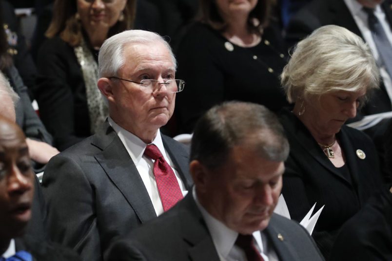 Former Attorney General Jeff Sessions listens during the State Funeral for former President George H.W. Bush at the National Cathedral, Wednesday, Dec. 5, 2018, in Washington. (AP Photo/Alex Brandon, Pool)