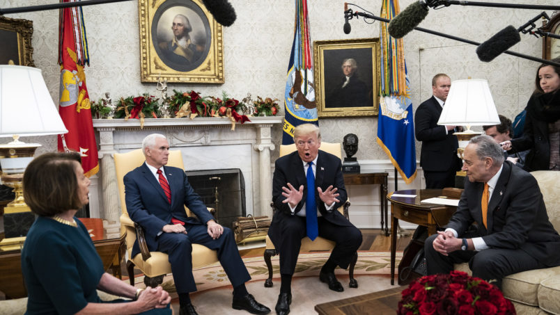 WASHINGTON, DC - DECEMBER 11 : President Donald J. Trump debates with House Minority Leader Nancy Pelosi, D-Calif., left, and Senate Minority Leader Chuck Schumer, D-N.Y., right, as Vice President Mike Pence listens during a meeting in the Oval Office of White House on Tuesday, Dec. 11, 2018 in Washington, DC. (Photo by Jabin Botsford/The Washington Post)
