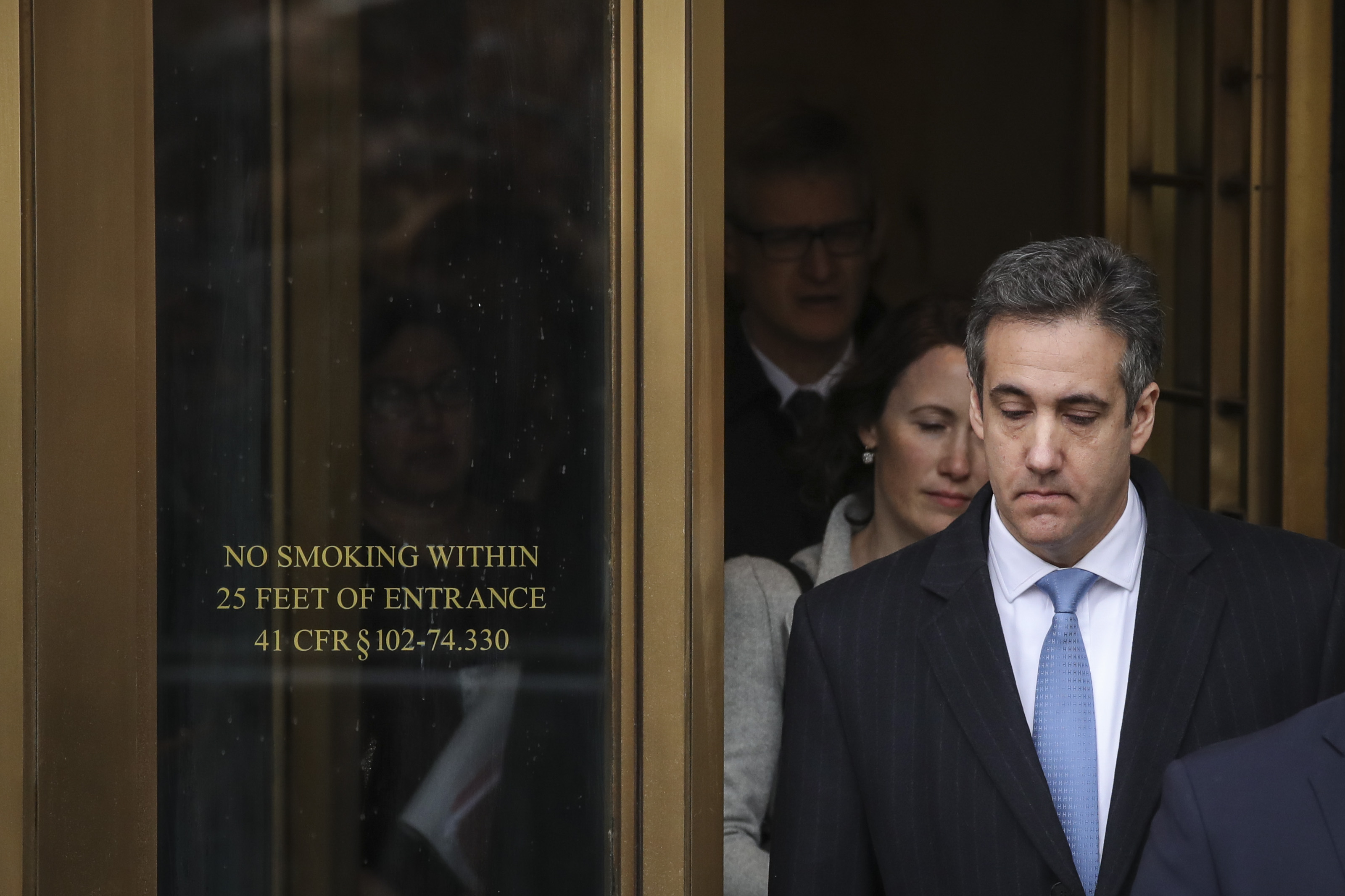 NEW YORK, NY - DECEMBER 12: Michael Cohen, President Donald Trump's former personal attorney and fixer,  exits federal court after his sentencing hearing, December 12, 2018 in New York City. Cohen was sentenced to 3 years in prison after pleading guilty in August to several charges, including multiple counts of tax evasion, a campaign finance violation and lying to Congress. (Photo by Drew Angerer/Getty Images)