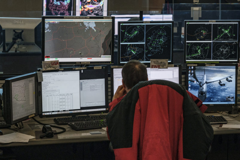 WARRENTON, VIRGINIA - NOVEMBER 16: Traffic Management Specialists monitor airline traffic at the Air Traffic Control System Command Center on Friday, November 16, 2018 in Warrenton, Virginia. The facility balances air traffic demand with system capacity in the National Airspace System and is a part of the Federal Aviation Administration (FAA) air traffic control system. (Photo by Pete Marovich For The Washington Post)