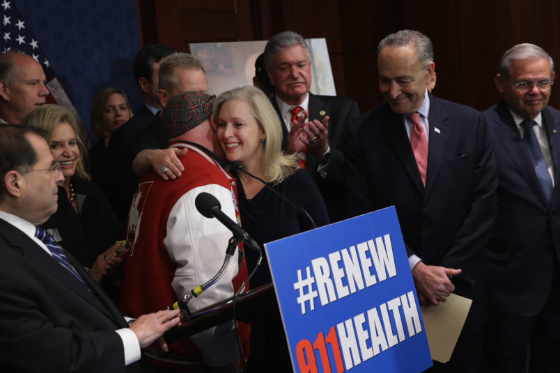 Sen. Kirsten Gillibrand, D-N.Y.; Sen. Chuck Schumer (D-NY) Rep. Carolyn Maloney (D-NY) Rep. Jerrold Nadler (D-NY), John Feal of the Feal Good Foundation hold a news conference at the U.S. Capitol after the Zadroga 9/11 health and compensation programs were included in the omnibus spending bill that passed Congress December 18, 2015 in Washington, DC. With a public awarness campaign lead by former Daily Show host Jon Stewart, the Zadroga legislation will provide money for healthcare for first responders and others suffering from diseases from the 9/11 attacks and for the families of those who have died.