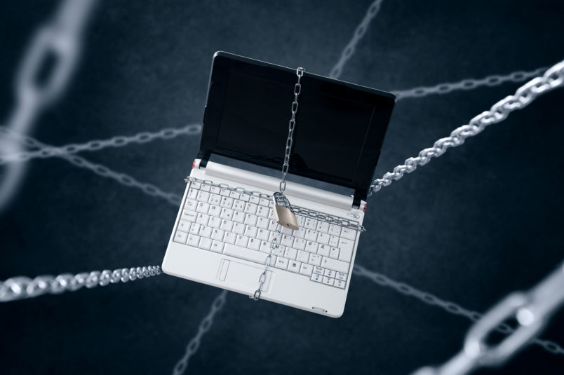 Chained laptop. Conception of sensitive data security.