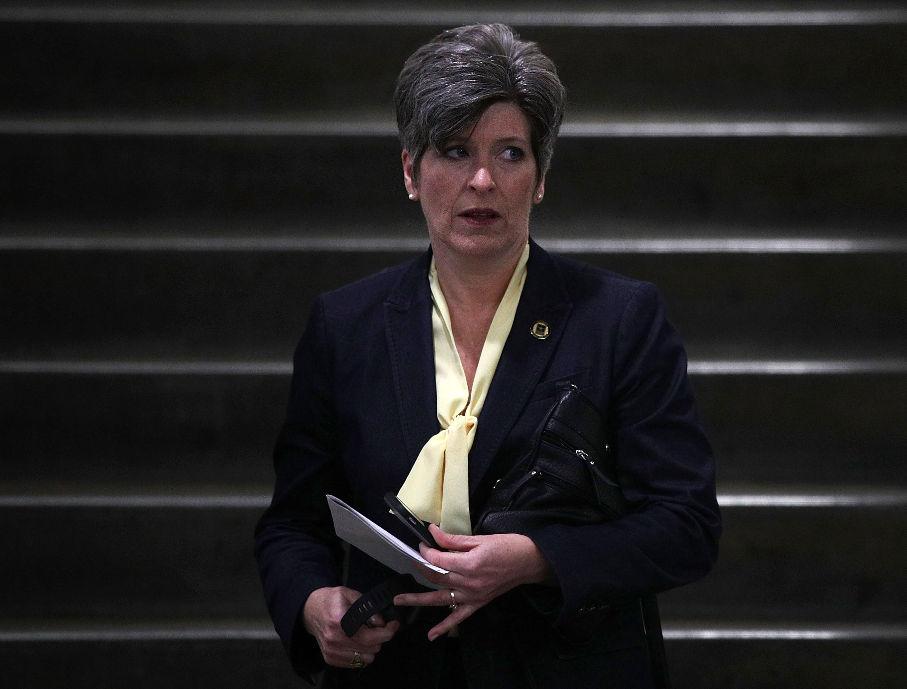 WASHINGTON, DC - APRIL 07:  U.S. Sen. Joni Ernst (R-IA) arrives for a closed briefing on the airstrikes against Syria by Chairman of the Joint Chiefs Gen. Joe Dunford April 7, 2017 at the Capitol in Washington, DC. Dozens of Tomahawk cruise missiles were launched by the U.S. targeting an airfield in Syria in response to a recent chemical attack that killed more than a hundred civilians.  (Photo by Alex Wong/Getty Images)