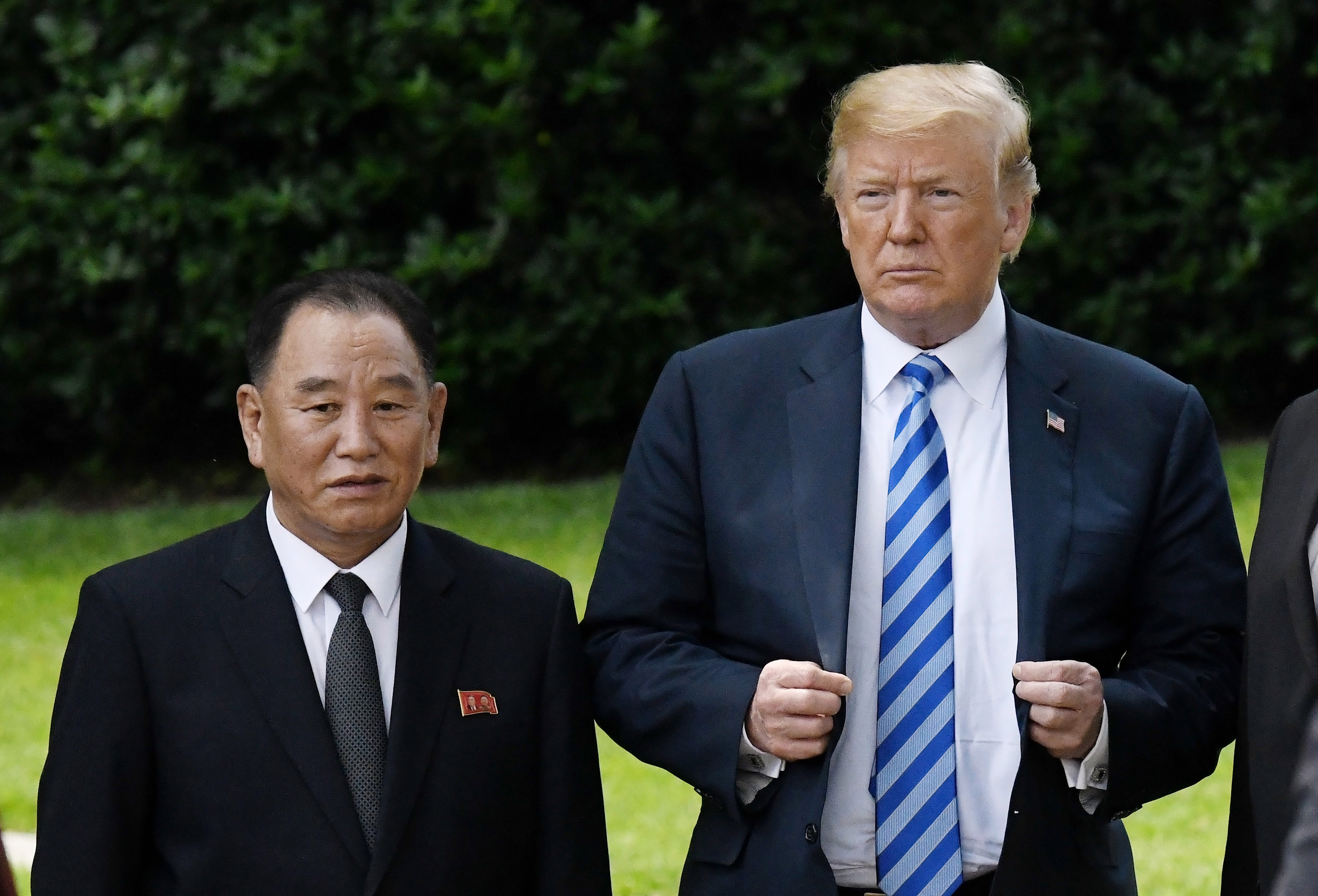 WASHINGTON, DC - JUNE 01: US President Donald Trump stands with Kim Yong Chol, former North Korean military intelligence chief and one of leader Kim Jong Un's closest aides, on the South Lawn of  the White House on June 1, 2018 in Washington, DC. Both Trump and Kim Yong Chol are trying to salvage a recently canceled historic summit between US President Donald Trump and North Korean leader Kim Jong-un scheduled for June 12. (Photo by Olivier Douliery-Pool/Getty Images)