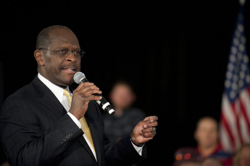 ROCK HILL, SC - DECEMBER 2:  Republican presidential candidate Herman Cain speaks to supporters during a town hall meeting at Laurel Ridge on December 2, 2011 in Rock Hill, South Carolina. Cain said he would make an announcement about his campaign in Atlanta tomorrow.  (Photo by Davis Turner/Getty Images)
