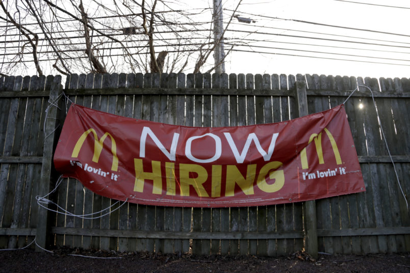 An employment sign hangs from a wooden fence on the property of a McDonald's restaurant Thursday Jan. 3 2019 in Atlantic Highlands N.J