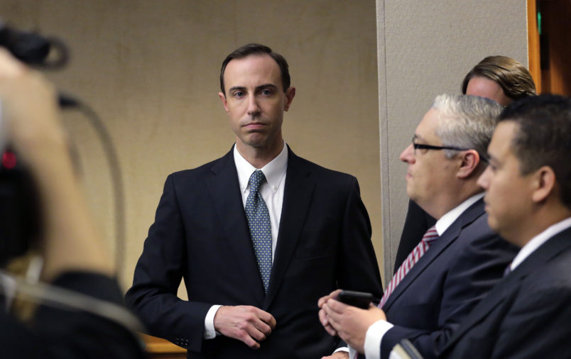 Secretary of State David Whitley, left, arrives for his confirmation hearing, Thursday, Feb. 7, 2019, in Austin, Texas, where he addressed the backlash surrounding Texas' efforts to find noncitizens on voter rolls. Whitley denies his office made mistakes over a list of 95,000 voters whose U.S. citizenship was called into question but included thousands of wrongly flagged names. (AP Photo/Eric Gay)