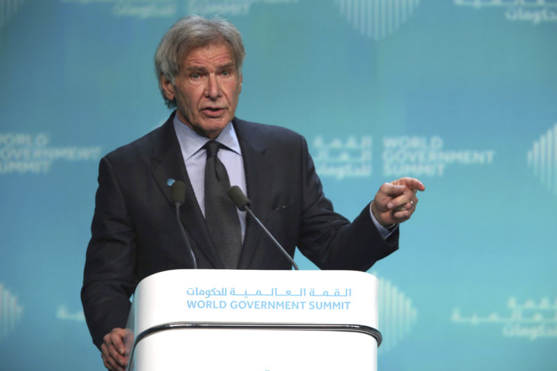 """American actor Harrison Ford speaks about ocean conservation at the World Government Summit in Dubai, United Arab Emirates, Tuesday, Feb. 12, 2019. Ford on Tuesday offered an emphatic plea for protecting the ocean while calling out those who """"deny or denigrate science."""" (AP Photo/Jon Gambrell)"""