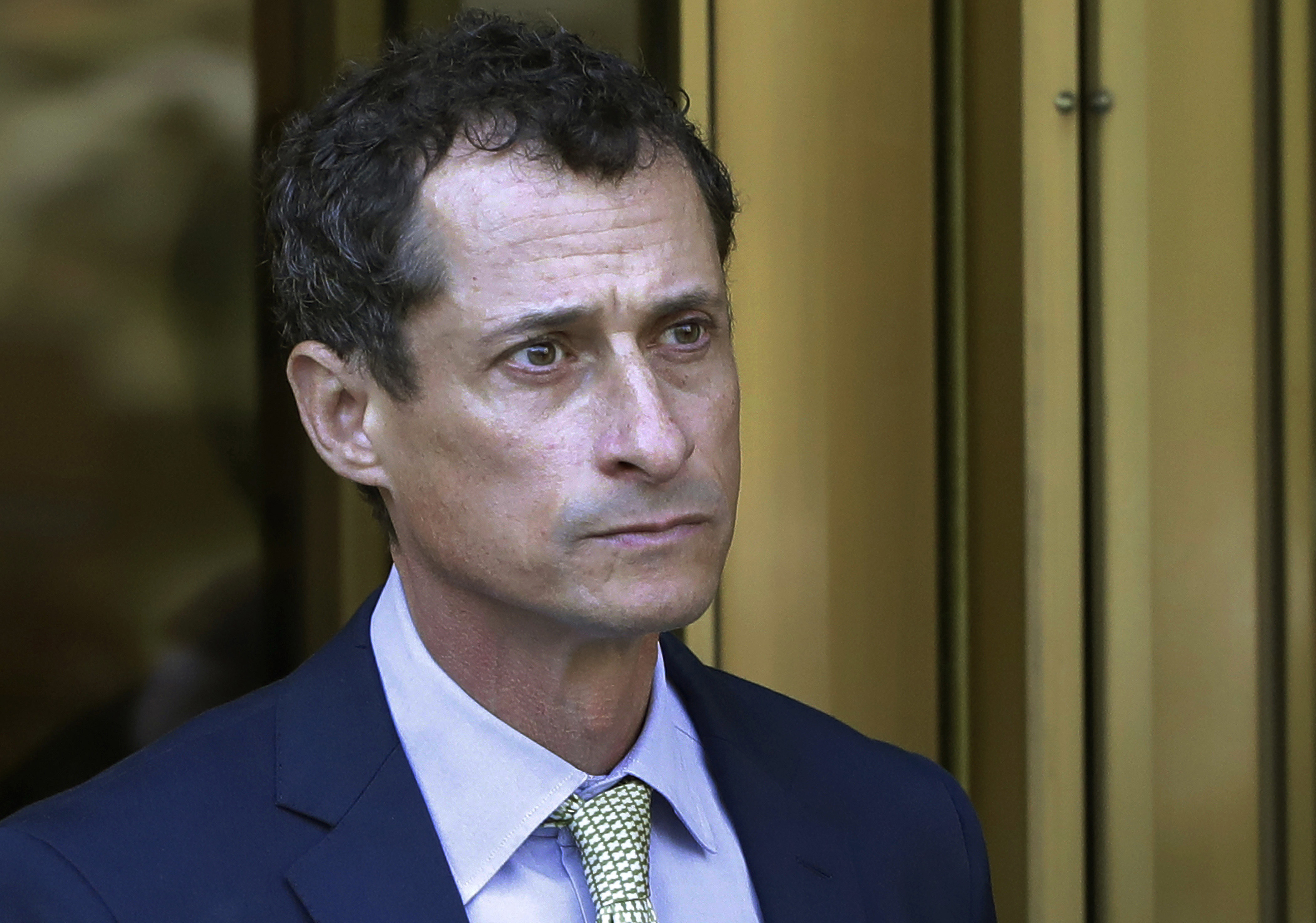 FILE - In this Sept. 25, 2017 file photo, former Congressman Anthony Weiner leaves federal court following his sentencing in New York. Weiner is set to report to the Federal Medical Center, Devens, Mass., Monday, Nov. 6, 2017, to serve his prison sentence in a sexting case that rocked the presidential race. (AP Photo/Mark Lennihan, File)