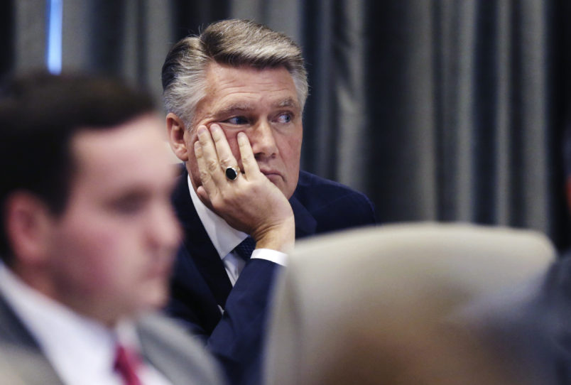 Mark Harris listens to the public evidentiary hearing on the 9th Congressional District investigation Monday afternoon, Feb. 18, 2019, at the North Carolina State Bar in Raleigh.