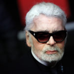 Fashion designer Karl Lagerfeld poses during the Champs Elysee Avenue illumination ceremony for the Christmas season, in Paris, Thursday, Nov. 22, 2018. (AP Photo/Christophe Ena)