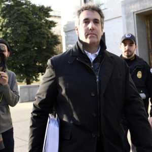Michael Cohen, President Donald Trump's former personal attorney, leaves Capitol Hill in Washington, Thursday, Feb. 21, 2019. (AP Photo/Susan Walsh)